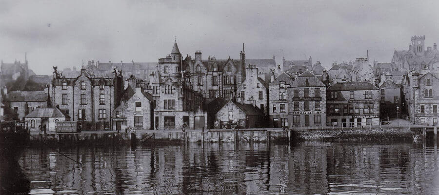 Old photograph of KGQ Lewick Hotels Grand Hotel taken from the Victoria Pier.